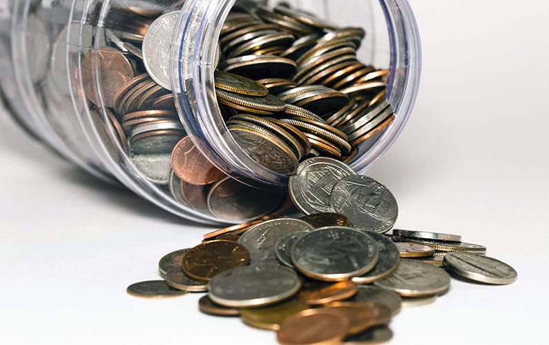 Photo of a jar of coins representing Penny Social to benefit GVRC